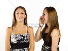 sharing secrets - A teen girl sharing secrets with her friend