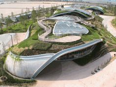 Grin Grin, Japan, a trio of arched pavilions, rise like grassy hillocks from the Island City Central Park in Fukuoka.