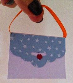 A mini purse paper bag made with the Tag Topper Punch. Great for decorating birthday parties with treats.