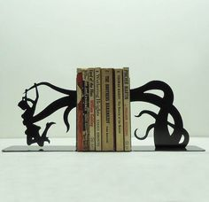 I love me some creative bookends.  Someday, I will have a big bookshelf with super awesome bookends like these. :D