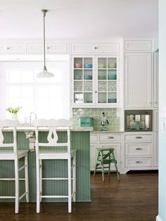 Painted Kitchen Islands - really love this color combo especially with that backsplash tile!