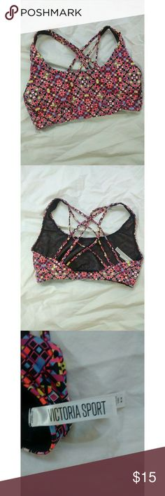Victoria Sport strappy sports bra Excellent used condition. It looks like it may have had some sort of padding inserts but those are no longer there. Victoria's Secret Intimates & Sleepwear Bras