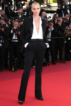 20 May Charlize Theron wore a classic black tux and white shirt to attend the premiere of The Last Face.   - HarpersBAZAAR.co.uk