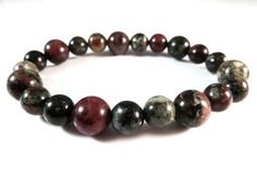 Eudialyte Stretch Bracelet 8mm 10mm Smooth Round Russian Gemstone Beads Rare Handmade by SandiLaneFineArt on Etsy