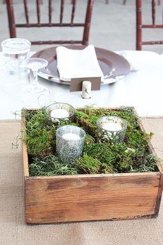 Mercury glass votives in moss in rustic box.