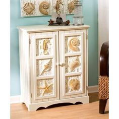 seashell 2 door cabinet coastal theme cabinet with seashell seahorse sand dollars and beach theme furniture 1000