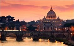View of the Tiber bridge Sant'Angelo and St. Peter's Cathedral. by yuppidu on 500px