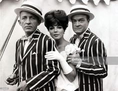 Entertainment, England, 2nd August 1961, Famous comedy acting duo Bing Crosby, left, and Bob Hope, right, are pictured with British actress Joan Collins on the set of the film 'Road to Hong Kong' being filmed at Shepperton, Middlesex