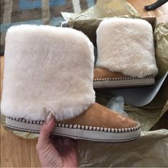 """UGG authentic KESTREL shearling cuff boots Sz 7 UGG authentic KESTREL shearling cuff boots Sz 7 new 100% AUTHENTIC STYLE 1007729 lush genuine-shearling cuff warms the shaft of an extravagant slipper boot fitted with a rubber sole, which is great, because you're never going to want to take it off. The soft, cozy lining is made from plush UGGpure™, a textile made entirely from wool but shaped to feel and wear like genuine shearling. 1"""" platform  7"""" boot shaft. Slip-on style. Suede and genuine…"""