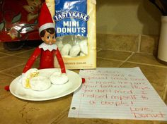 Donut helping himself to the donuts that Santa sent to Aiden - 2013