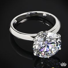 "This ""Classic tiffany style Knife-Edge"" Solitaire Engagement Ring is set in platinum and holds an outstanding 6.450ct Expert Selection Round Diamond!"