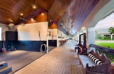 horse barn aisle with wash stalls open to center courtyard