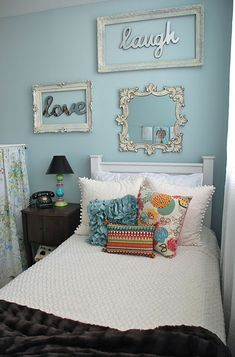 picture frames around words on the wall. pretty cute. love the bedding and pillows, too!