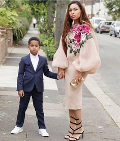 Our Dzyn Ambassadors don't play ! We are drooling over how blogger mum @alerobuttercup slayed in Dzyn as a wedding guest & her son compliments her perfectly ! Check out her blog for more details #shopdzyn #dzynnigeria #dzynambassadors #buynigerian #wearnigerian #gorgeous #dress #abujabrand #nigerianbrand #abujadesigners #abujafashion #instafashion #trends #fashiontrends #beauty #trendsetters