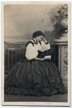Young Victorian woman reading.