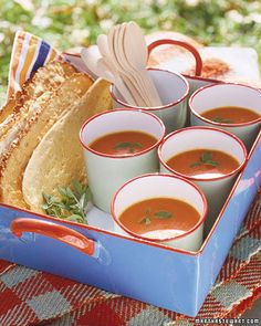 Fresh Tomato Soup - Martha Stewart  Yield: Serves 6    Ingredients:    6 tablespoons extra-virgin olive oil  1 large yellow onion, finely chopped  9 garlic cloves, crushed  6 sprigs marjoram, plus more for garnish  7 pounds ripe orange or red tomatoes (about 14), coarsely chopped  1 teaspoon sugar  Coarse salt and freshly ground pepper