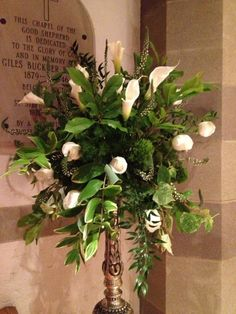 Calla lilies and giant white roses enhanced with Solomon's seal via The Gracious Posse