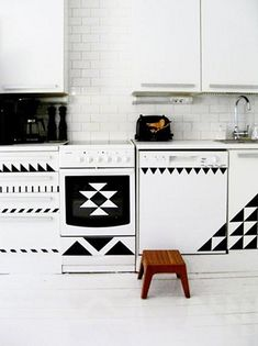 Use contact paper to make geometric designs on cabinets and appliances
