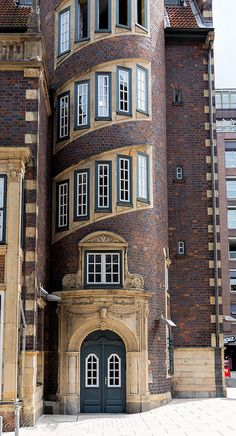 Building with windows for a spiral staircase on the main street of Hamburg, Germany - photo by Kim Toft / Toftus Photography, via Flickr