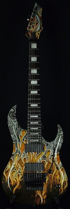 """Welcome, you are looking at a great piece. This is the Autographed Dean Michael Batio MAB7 Warrior 7-String Guitar. 25.5"""" scale. 1.88"""" nut width. 8 lbs 15oz. .85"""" depth at the 5th fret. Played and handsigned by Michael Batio at a recent clinic in our store. The Dean Michael Batio MAB7 Warrior 7-String guitar is a mod-metal and shredders dream, with superb playability, Floyd Rose tremolo, and custom Tribal Flame graphics. The resonant alder body has the Batio profile with contours for a super…"""