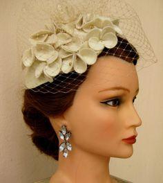 Handmade 40's style creme off white felt hat with handmade flowers. €65.00, via Etsy.