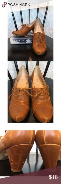 Cognac ModCloth oxfords Reposhing this great pair of shoes (moving!). They're cognac leather-look heeled oxfords that lace up. Attractive detailing, completely timeless. The previous posher never wore them; I wore them once. Her cat scratched the heels, as shown. That's not visible unless you're eye-to-eye with the heels themselves. There are a couple of other mild scuffs and virtually no sole wear. ModCloth Shoes Heels