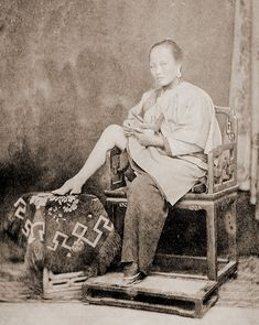 Chinese woman showing her little foot c.1865