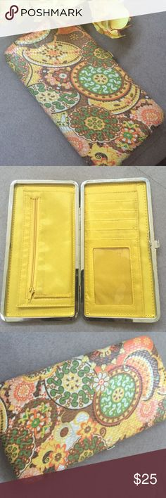 Adorable bohemian designed snap clutch barely used ✨Super cute & adorable bohemian style clutch with push button clasp. Barely used, brand new condition. Yellow interior with credit card and clear ID pocket. Both sides have pockets for bills, cell phone, etc. also has a zipper pocket for coins. 100% cotton lining, interior is 100% nylon.✨ Bags Clutches & Wristlets