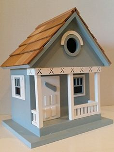 Blue Lake Cottage Birdhouse is a Whimsical and Peaceful Lakefront Blue Cottage that is a fully functional Outdoor Wood Birdhouse. |  http://landscapeandlighting.net