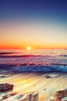 Sunrise over sea by Valentin Valkov
