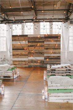 industrial wedding decor ideas with pallets and hanging lighting #weddingceremony #weddingdecor #weddingchicks http://www.weddingchicks.com/2014/04/09/illuminated-industrial-wedding-ideas/