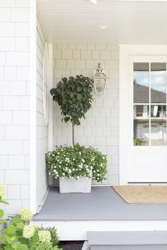 square planters with topiary white lilac and double white wave petunias make for a beautiful cape cod combo! Thanks for trusting my mom and I with your front porch Tori! White Exterior Houses, Grey Exterior, Grey Houses, Exterior Paint Colors, Exterior House Colors, Brick Houses, Small Houses, Br House, Small Front Porches
