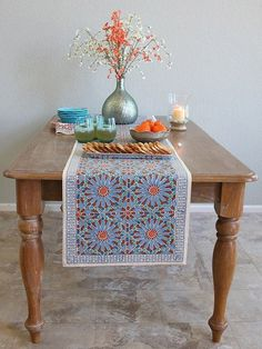 Mosaique Bleue Window Valance: An intricate Moroccan tile print, consisting of cyan blue star burst motifs, set in pieces of chocolate tile, with accents of french blue, peacock green and apricot. Morrocan Table, Indian Table, Moroccan Theme, Moroccan Design, Dining Table Runners, Table Covers, Table Linens, Seasonal Decor, Table Decorations
