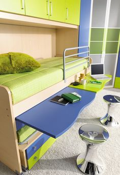 Pull out desks with a trundle bed hidden below - cool. If I ever have my boys home, this would be awesome!
