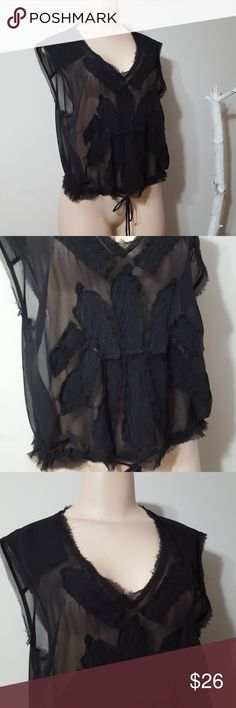 FREE PEOPLE BLACK SHEER & EMBROIDERED TOP! FREE PEOPLE BLACK SHEER & EMBROIDERED TOP! Super cute top! Black sheer fabric base. Black embroidered trim front design. Drawstring bottom. Perfect condition! 100%poly. Free People Tops Blouses