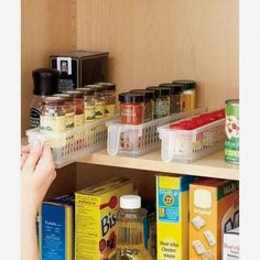 "These Perfect Pantry Basket Sets will help keep a neat and organized kitchen. Easily see the contents through the clear design with small square holes. Each basket's handle allows for quick retrieval of hard-to-reach items. The Set of 3 Spice Baskets (3""W x 12""D x 2-1/2""H, each) can hold jars or cans. Polypropylene. Top rack dishwasher safe. Use them in the fridge, laundry room, bathroom or under the sink. Details: 3""W x 12""D x 2-1/2""H, each. Polypropylene Top rack dishwasher safeUse t.."