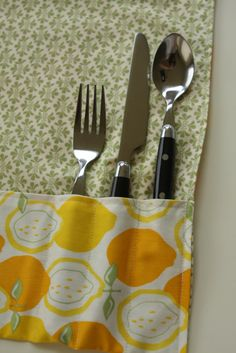 A super cute and easy way to make a roll-up napkin or placemat that can hold utensils.  This would be great for keeping the eating utensils organized and clean on the road - simply pull out and put on the camp table and you're set!
