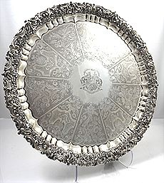 "Large 24"" English Antique Silver Salver by Wm Eley dated 1824. The cast pierced floral border is of exceptional quality & the center is hand engraved with panels of flowers. A large crest is engraved in the center cartouche. Large ornate feet are applied to the bottom."