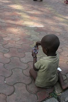 street kids playing with torn cards ..
