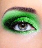 Fashion make-up of woman eye with green eyeshadows stock photography