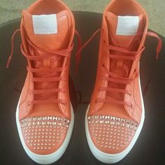 D/C REDUCED! Gucci California Orange Stud Sneaker HOT EXCLUSIVE LISTING!  Women Shoes: A retro high-top goes modern in smooth leather and precision-placed studs. The style shines on with Gucci's logo embroidered at the tip of the tongue.  Leather upper and lining/rubber sole. By Gucci; made in Italy. Salon Shoes.  Nordstrom floor Model. (Brand New/Missing Box)  Item will shop within 24 hours of purchase Gucci Shoes