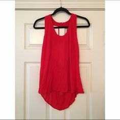 Backless Coral Tank Top This great color combined with the caged back and high-low design make this top easily transition from day to night! Please let me know if you have any questions! ANGL Tops Tank Tops