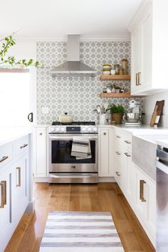 Love looking for great white kitchen decorating ideas? Check out these gallery of white kitchen ideas. Tag: White Kitchen Cabinets, Scandinavian, Small White Kitchen with Island, White Kitchen White Witchen Countertops Kitchen Ikea, Kitchen Rug, New Kitchen, Kitchen Cabinets, Cheap Kitchen, Apartment Kitchen, White Cabinets, Quirky Kitchen, 1960s Kitchen