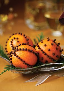 Clove studded oranges. One of my favorite traditions! They look (and smell!) lovely!