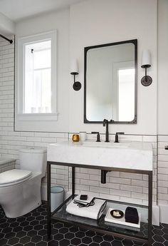 Modern black and white bathroom is lit by Modern Taper Sconces with Linen Shades mounted on either side of an Industrial Rivet Flat Mirror located above a Hudson Metal Single Washstand finished with a matte black faucet. Wood Bathroom, Bathroom Wall Decor, Bathroom Interior Design, Home Interior, Modern Bathroom, Small Bathroom, Bathroom Mirrors, Industrial Bathroom Vanity, Basement Bathroom