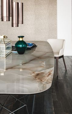 That beautiful green/aqua coloured glass vase and copper lamps, against natural stone makes a beautiful colour palette