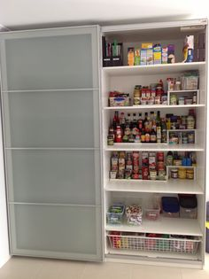 Ikea Pax Wardrobe used as a kitchen pantry, but I'd install drawers for most of the shelving... deep shelves like that can make finding stuff challenging.