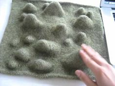Interactive felted textile - Felted capacitive sensors + piano arduino code (lilypad arduino). Project for MIT New Textiles