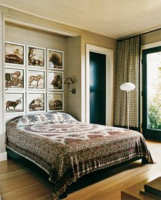 Lake House by Thom Filicia Inc. - Eclectic bedroom with animal art