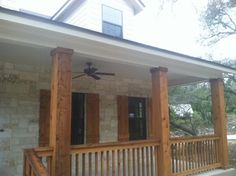 Texas Hill Country stone home with cedar columns, porch railings, and cedar shutters by Kurk Homes Front Porch Railings, Front Porch Design, Porch Columns, Front Porches, Wood Columns, Porch Designs, Front Deck, Stair Railing, Cabana